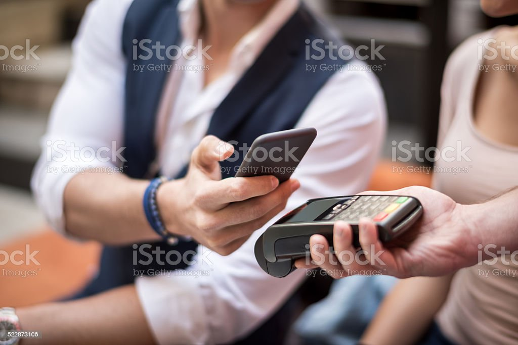 Customer paying with mobile phone stock photo