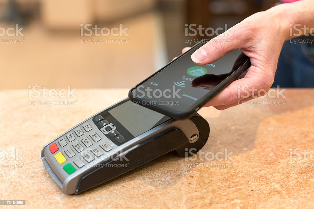 Customer paying with NFC technology stock photo
