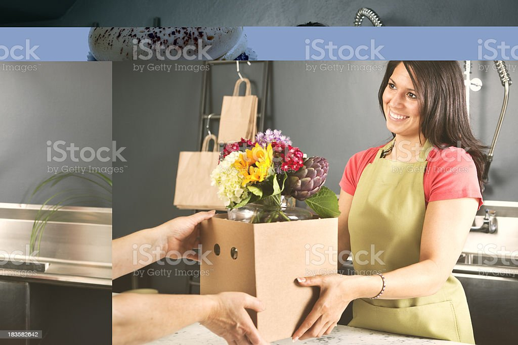 Customer Purchasing Flowers and Vase from Florist in Flower Shop royalty-free stock photo