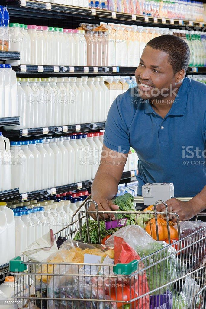 customer pushing a shopping trolley stock photo