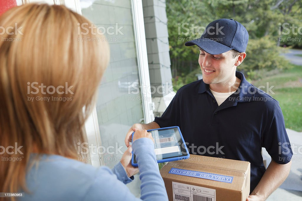 Customer Receiving Package from Delivery Service at the Door Hz stock photo