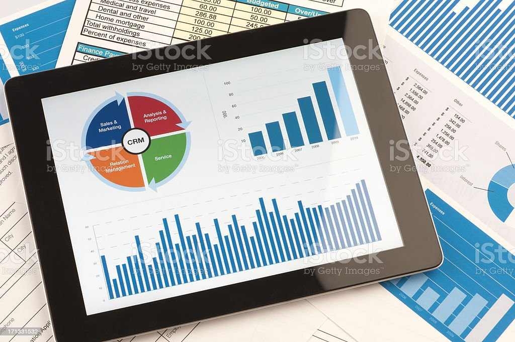 Customer Relationship Management business chart on a digital tab stock photo