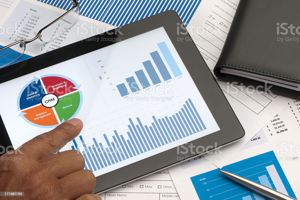 Customer Relationship Management business chart on digital table stock photo