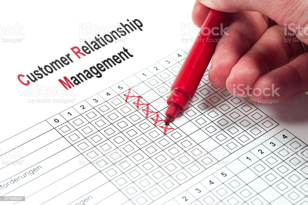 Customer Relationship Management with red pen stock photo