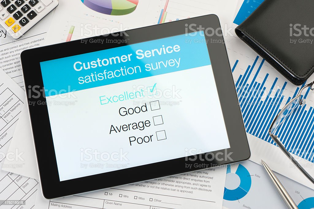Customer satisfaction survey on a digital tablet royalty-free stock photo