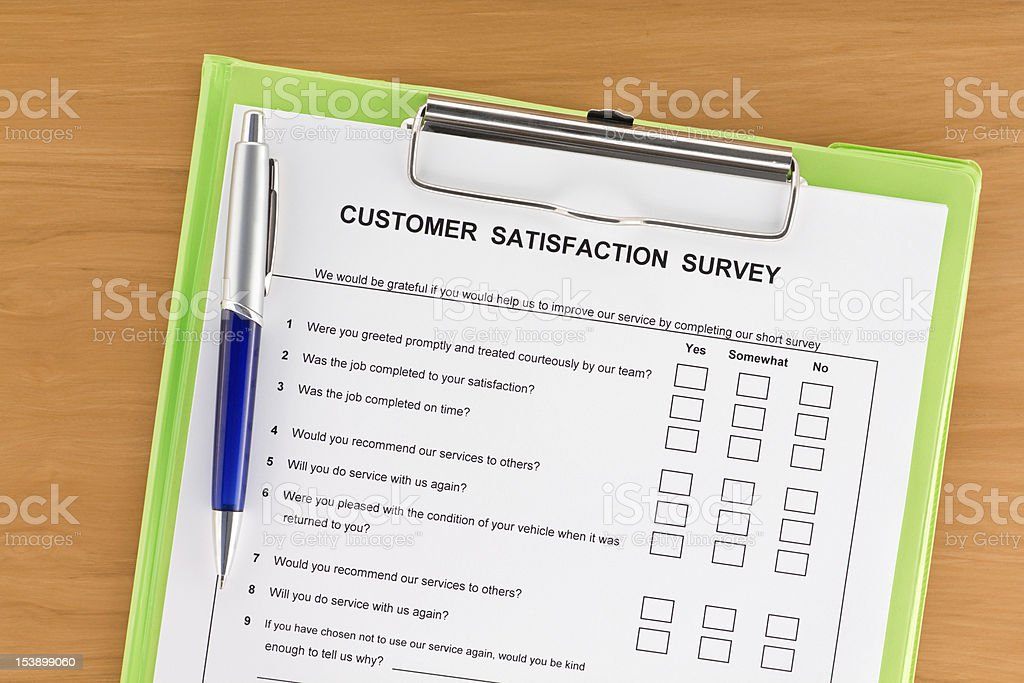 Customer Satisfaction Survey on Clipboard with Pen royalty-free stock photo