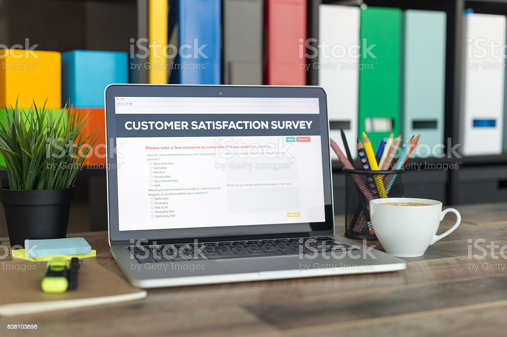Customer Satisfaction Survey on Laptop Screen stock photo