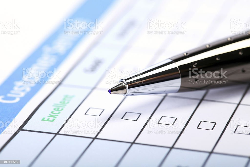A customer satisfaction survey with a pen royalty-free stock photo
