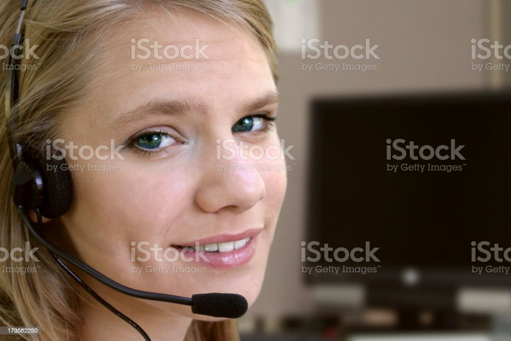 Customer service agent against a comptuer. stock photo