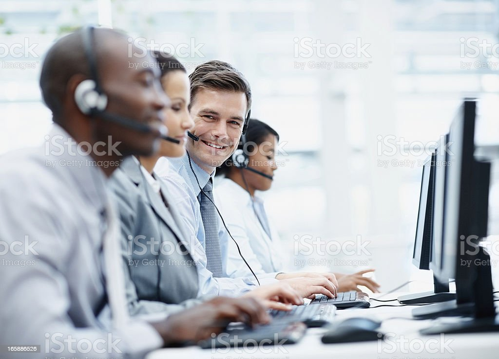 Customer service executives working in front of computer royalty-free stock photo
