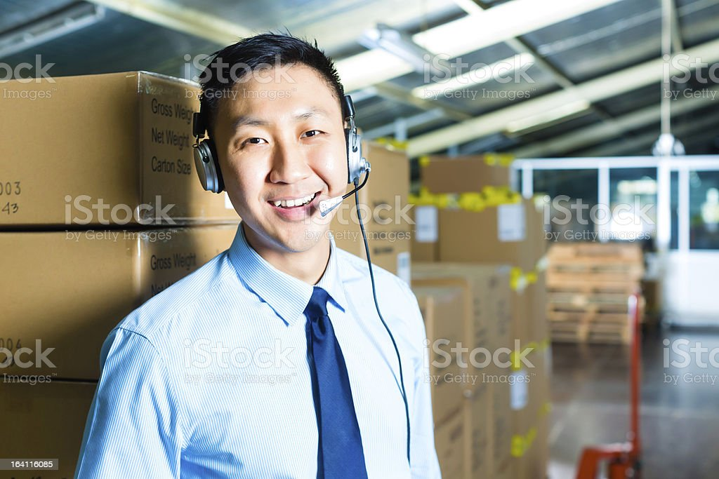 Customer Service in a warehouse royalty-free stock photo