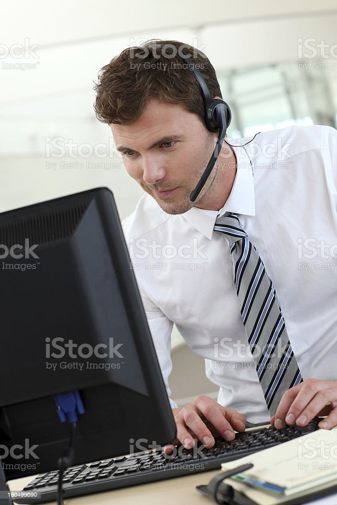 Customer service in action with haedphone and computer royalty-free stock photo