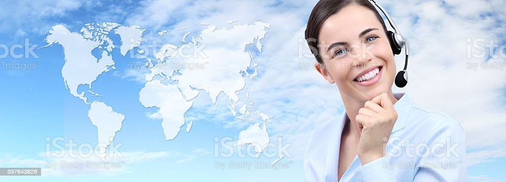 Customer service operator woman with headset smiling, world map stock photo
