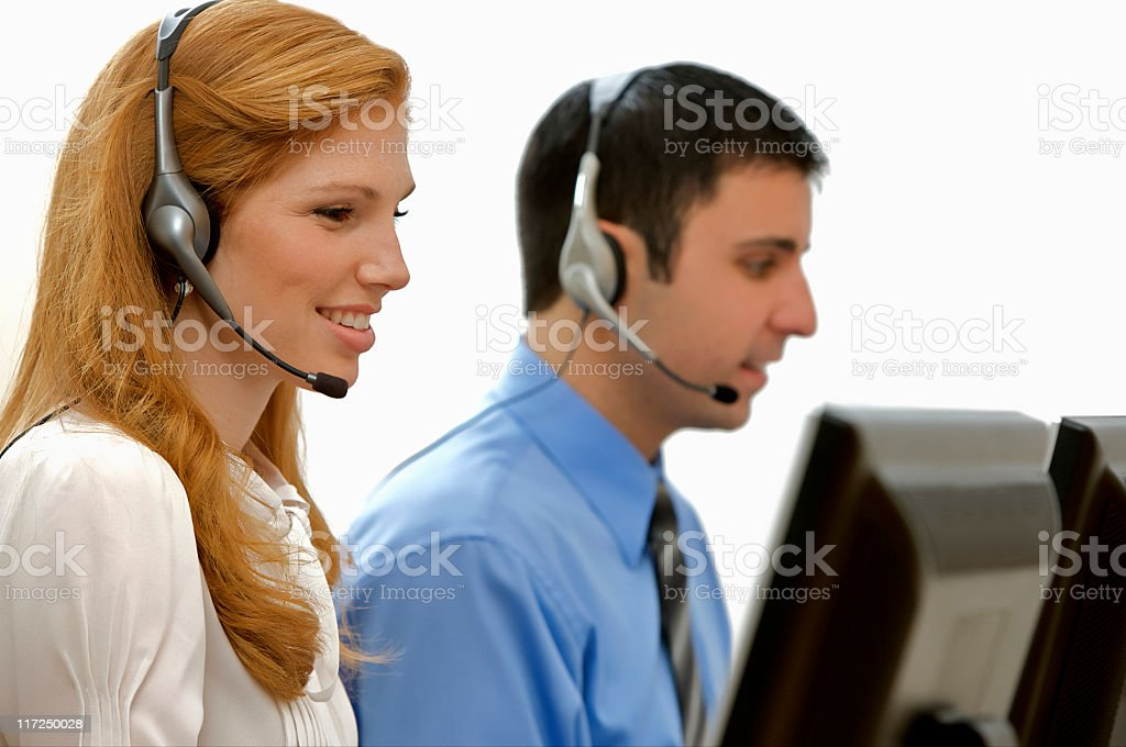 Customer Service Represemtatives Wearing Headsets royalty-free stock photo