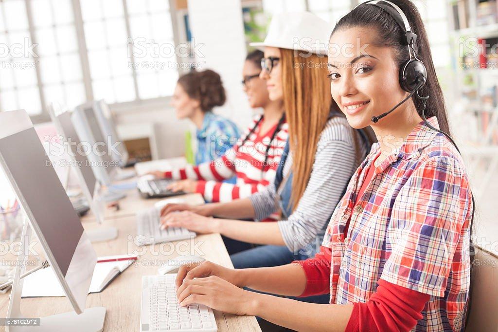 Customer service representative female team at modern workplace stock photo
