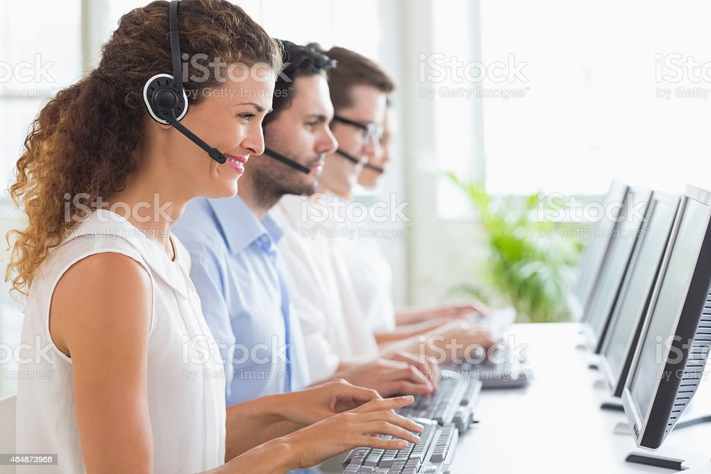 Customer service representatives working at desk stock photo
