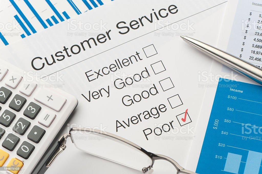 Customer service survey, a pen, and adding machine stock photo