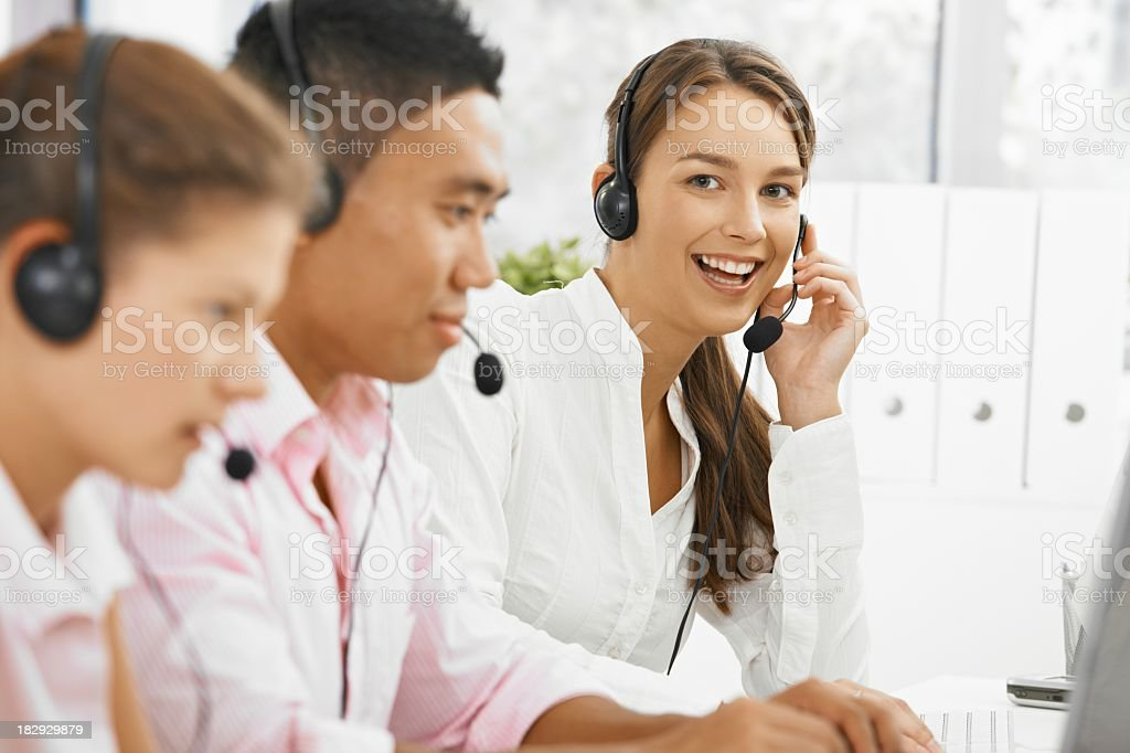 Customer service team dressed in white working happily royalty-free stock photo