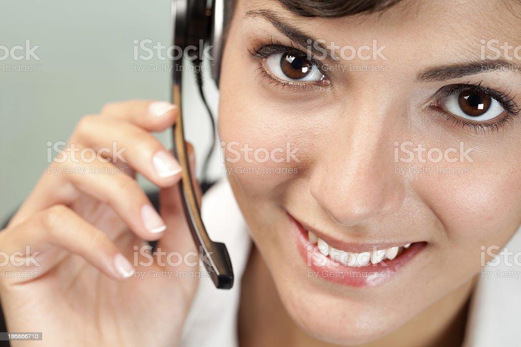 Customer service woman looking at the camera royalty-free stock photo