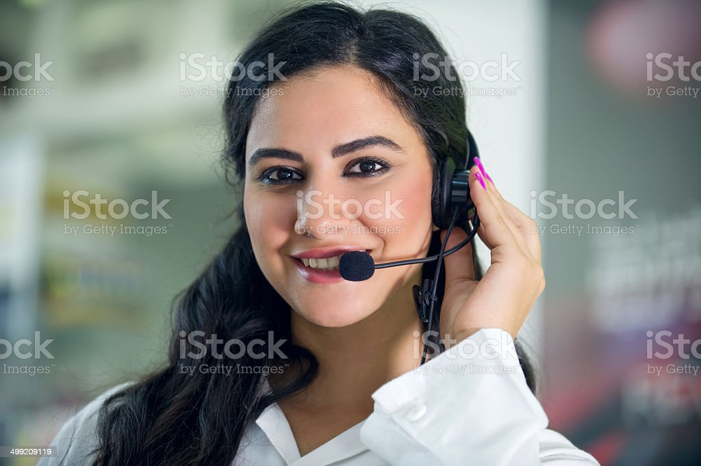 customer service worker, call center smiling operator with phone headset stock photo