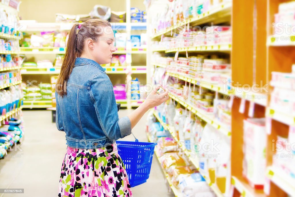 Customer Shopping in Supermarket Store for Home Domestic Supply stock photo