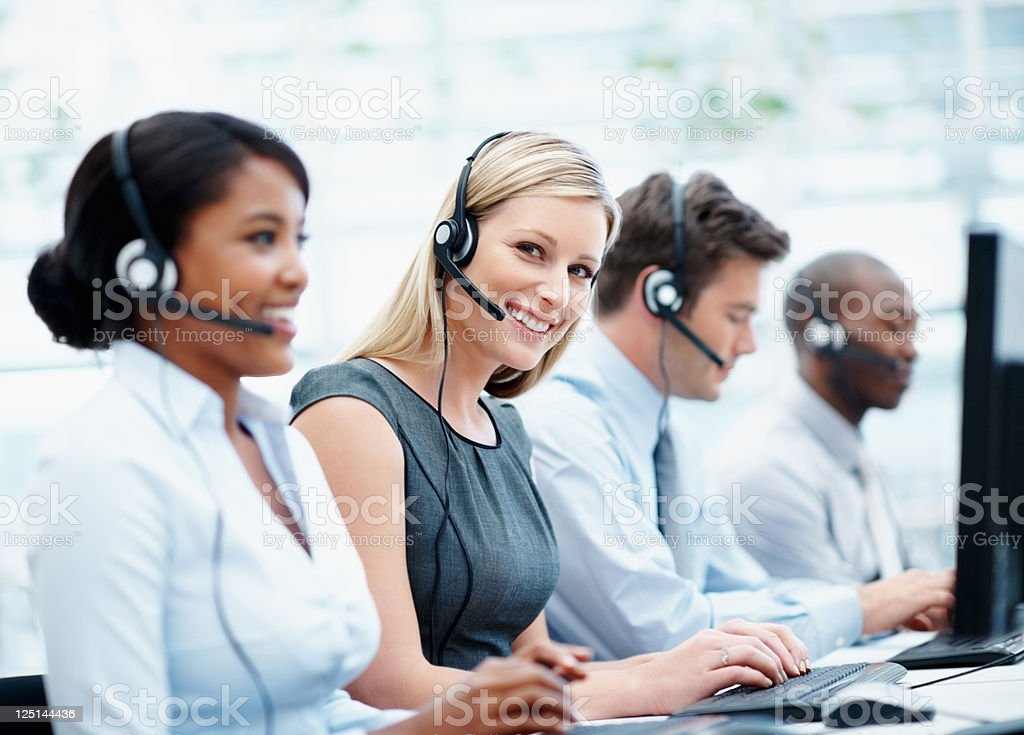 Customer support representatives working stock photo