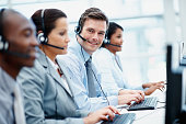 Customer support team in an office wearing headsets