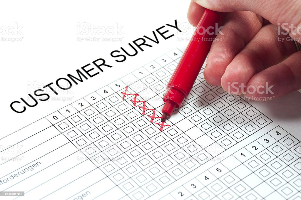 customer survey with hand and pen stock photo