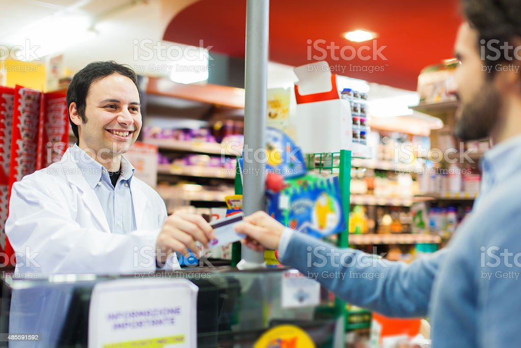 Customer using a credit card to pay in the supermarket stock photo