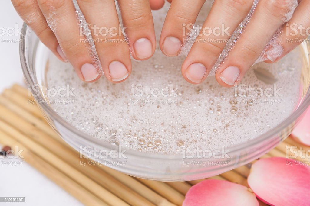 Customer washing their nails stock photo