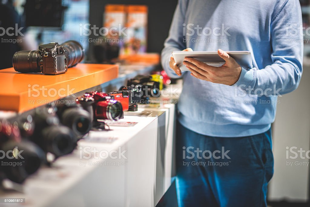Customer with digital tablet stock photo