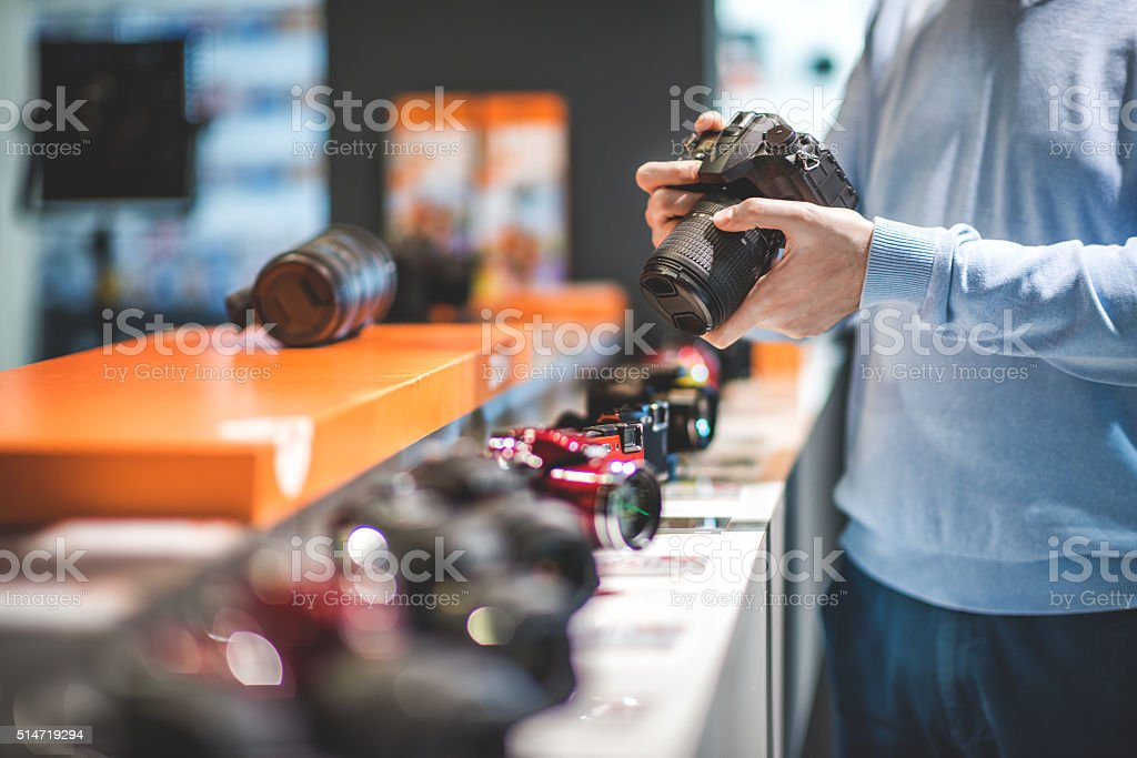 Customer with DSLR camera stock photo