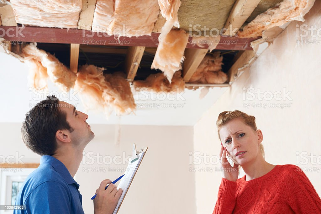 Customer worried about ceiling repair while getting estimate royalty-free stock photo