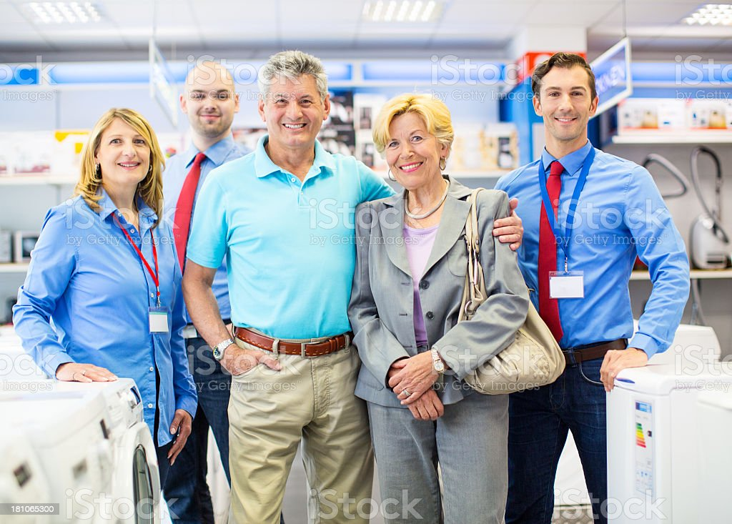Customers and sellers at a retail store royalty-free stock photo