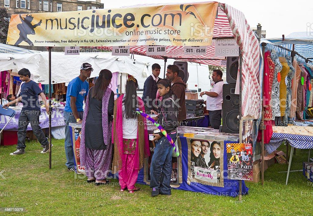 Customers and vendors at a MusicJuice stall; Edinburgh Mela stock photo