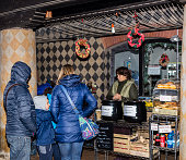 Customers are buying mulled wine during a Christmas market