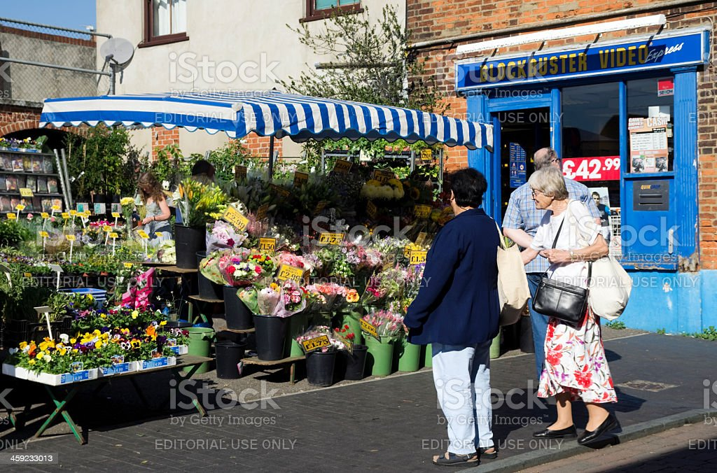 Customers at a flower and plant stall royalty-free stock photo