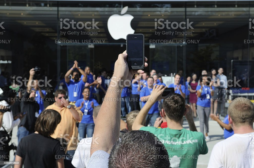 Customers at Apple Store Grand Opening stock photo