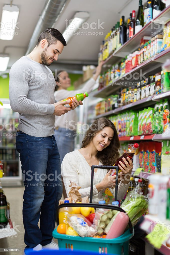 Customers at beverages section of supermarket stock photo