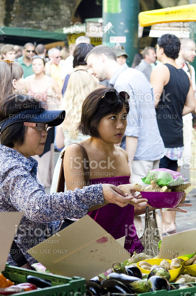 Customers at Borough Market, London royalty-free stock photo
