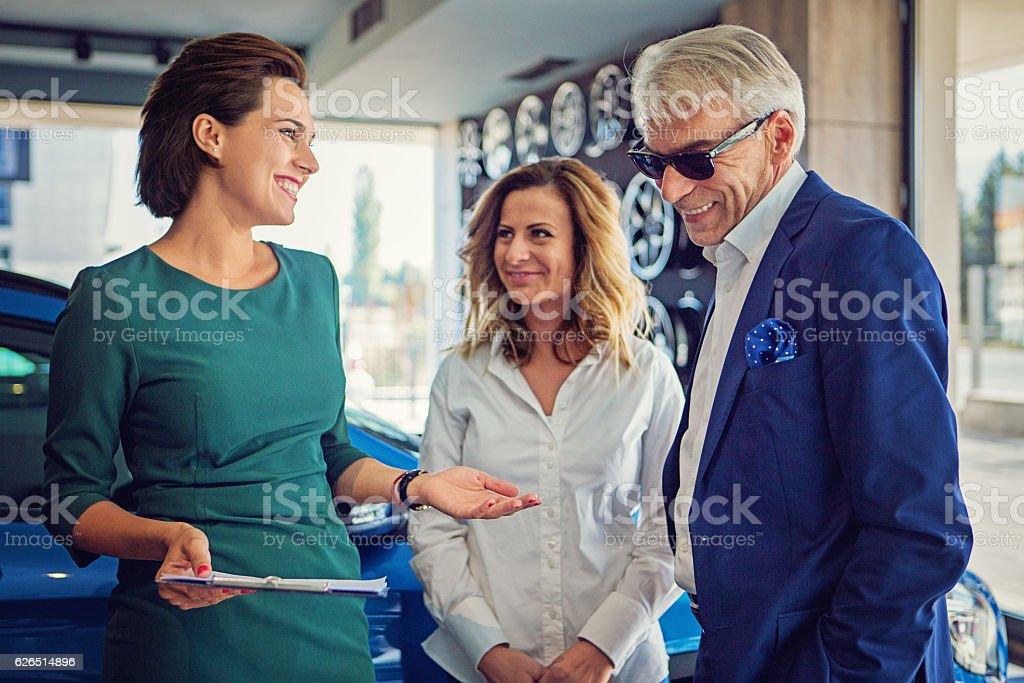 Customers buying new car stock photo