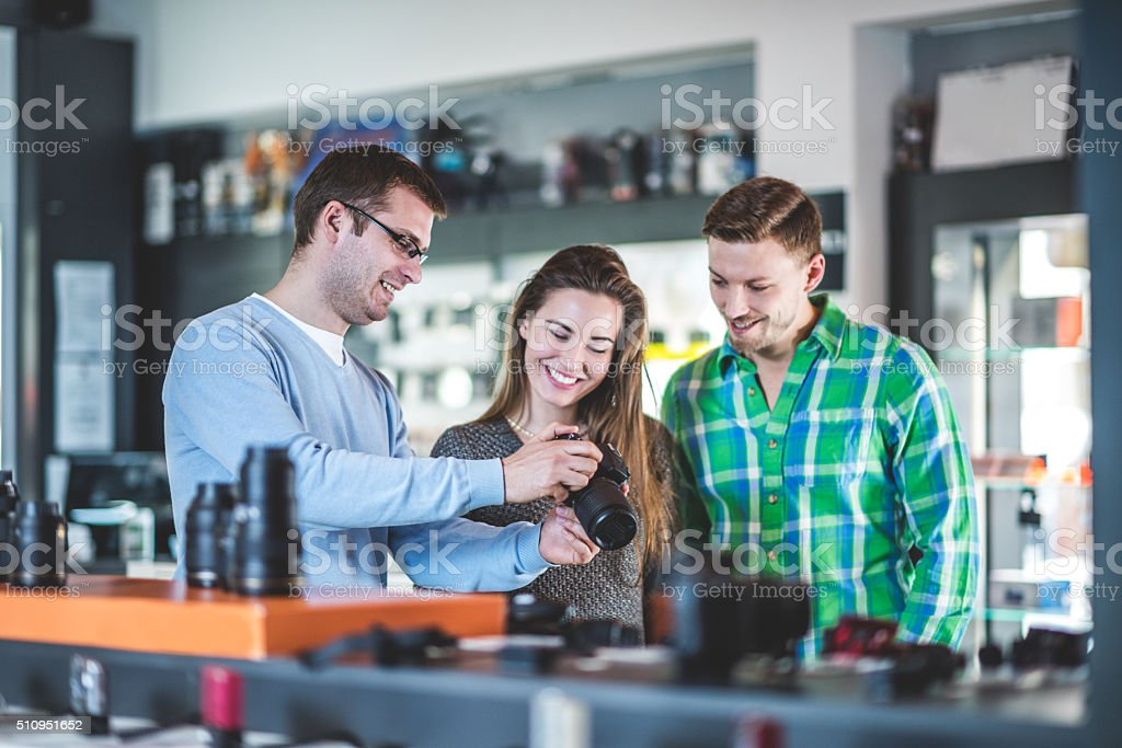 Customers buying photographic equipment stock photo