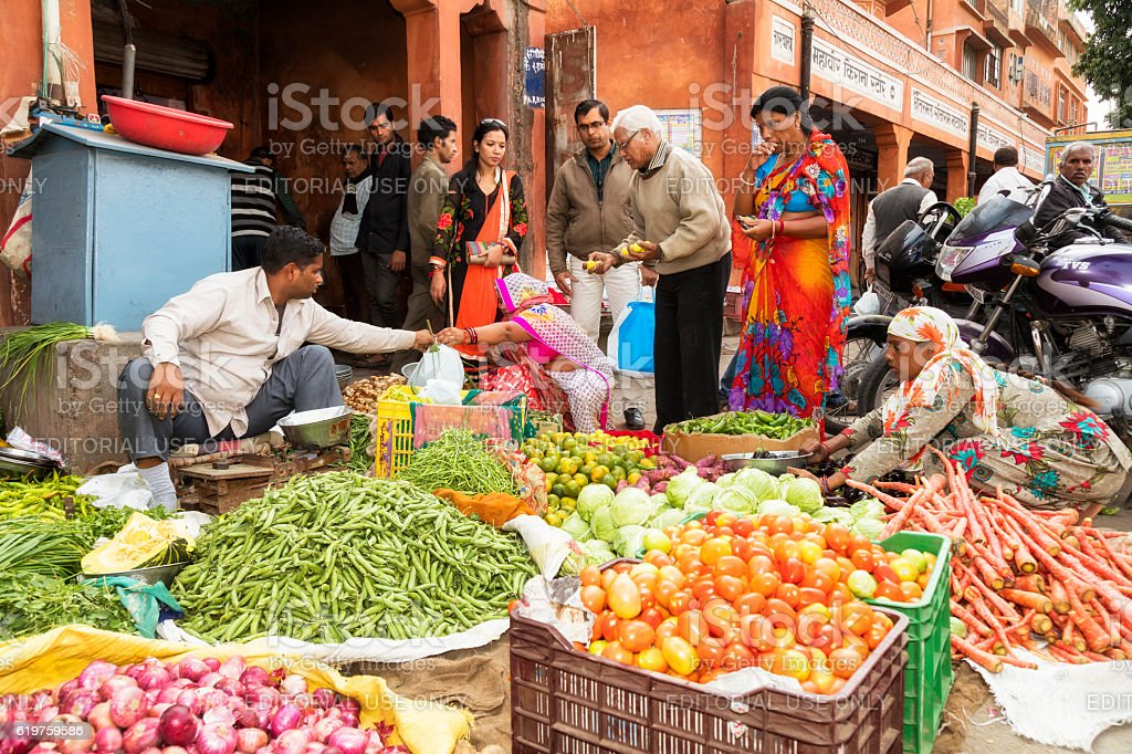 Customers buying vegetables on the street, Jaipur, Rajasthan, India stock photo
