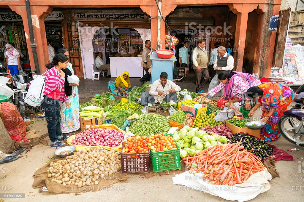 Customers buying vegetables on the street, Udaipur, Rajasthan, India stock photo