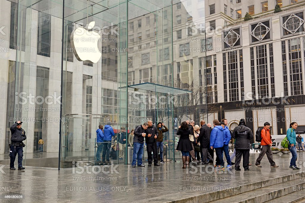 Customers crowd retail store for Apple Watch stock photo