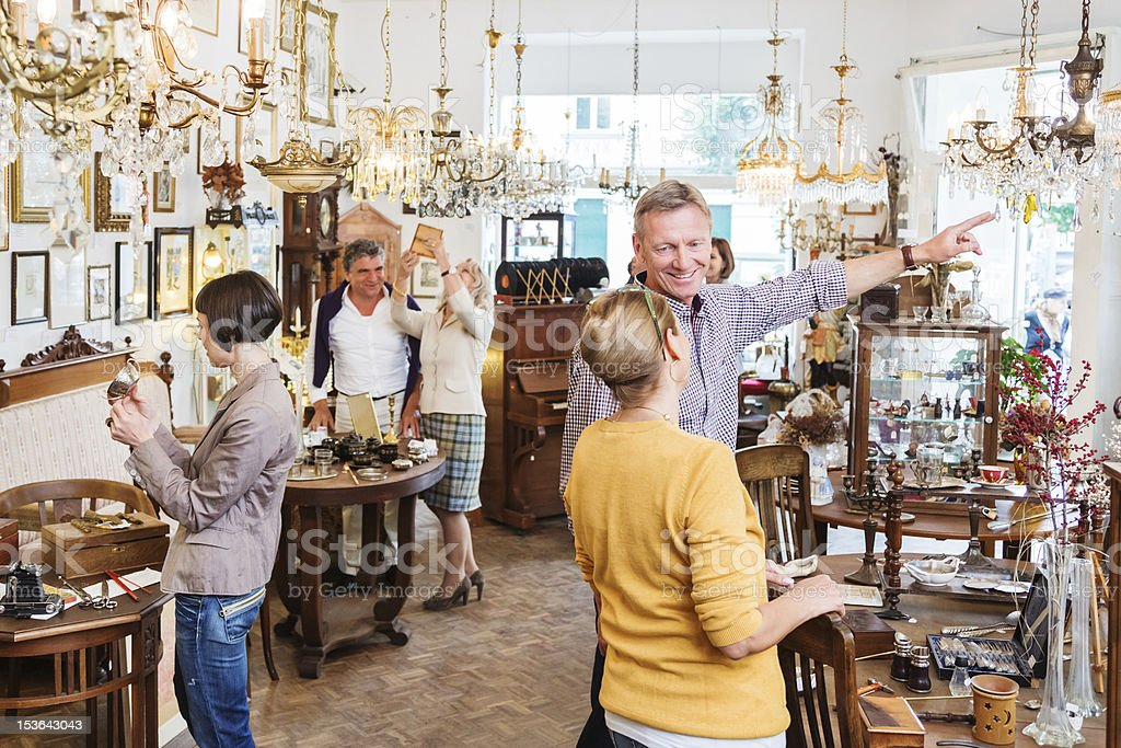 Customers In Antique Store stock photo