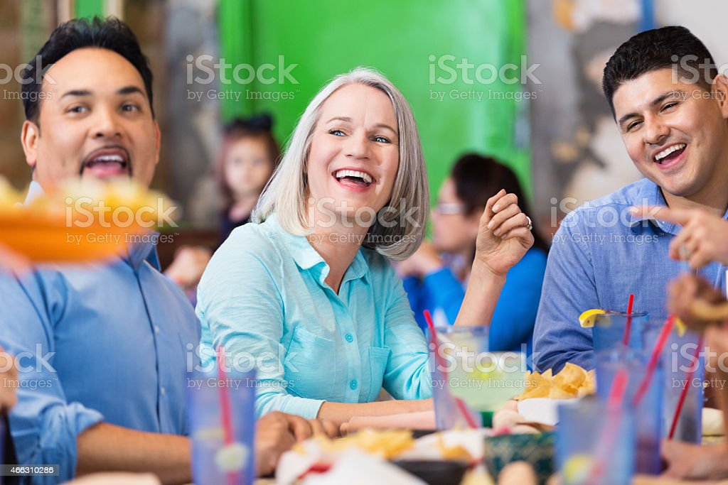 Customers in casual restaurant excited about meal stock photo