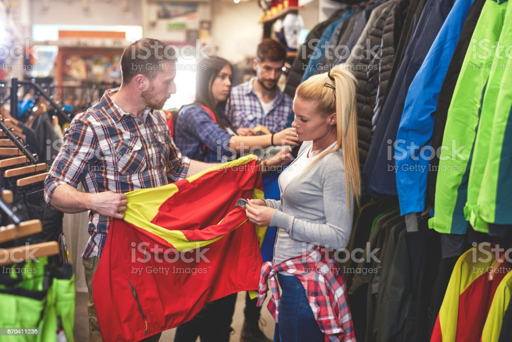 Customers in sports store stock photo