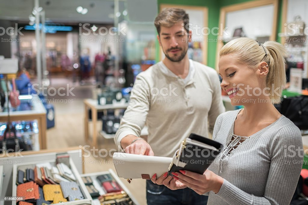 Customers inside luggage store stock photo