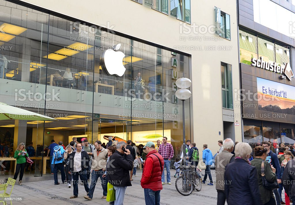 Customers on line outside the Apple Store in Munich stock photo